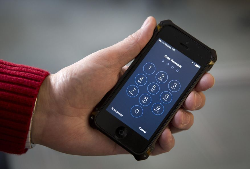 In this Feb. 17, 2016, file photo an iPhone is seen in Washington. The Supreme Court is hearing a case on Nov. 29, 2017, about privacy in the digital age that tests whether police generally need a warrant to review cellphone tower records. (AP Photo/Carolyn Kaster, File)