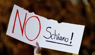 "A Tennessee fan holds a sign reading ""No Schiano!"" during a gathering of Tennessee fans reacting to the possibility of hiring Ohio State defensive coordinator Greg Schiano for its head coaching vacancy Sunday, Nov. 26, 2017, in Knoxville, Tenn. (Calvin Mattheis/Knoxville News Sentinel via AP) **FILE**"