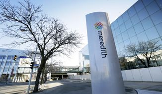 FILE - This March 11, 2015, file photo shows the Meredith Corp. headquarters building in Des Moines, Iowa. Meredith Corp. said Sunday, Nov. 26, 2017, that it is buying Time Inc. for about $1.8 billion in a deal that joins two giant magazine companies. (AP Photo/Charlie Neibergall, File)