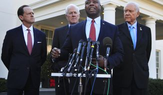 Senate Finance Committee member Sen. Tim Scott, R-S.C., front, with, from left, Sens. Patrick Toomey, R-Pa., John Cornyn, R-Texas, and Chairman Orrin Hatch, R-Utah, speaks to reporters following a meeting with President Donald Trump at the White House in Washington, Monday, Nov. 27, 2017. (AP Photo/Manuel Balce Ceneta)