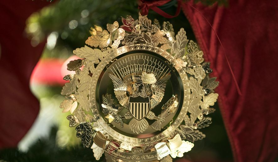 the first familys official christmas ornament is seen on a tree in - 2017 White House Christmas Decorations