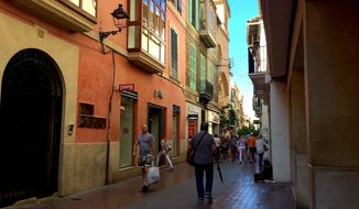 A morning stroll through Mallorca, Spain's medieval mountain town of Soller brings coffee stops and odd notion shops.