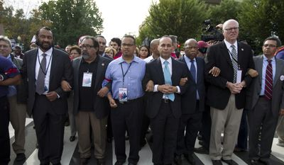 From left, Rep. Al Green, D-Texas, Rep. Raul Grijalva, D-Ariz., Rep. Keith Ellison, D-Minn., Rep. Luis Gutierrez D-Ill., Rep. John Lewis, D-Ga., and Rep. Joseph Crowley, D-N.Y., second from right, march on Capitol Hill during a immigration rally in Washington. Mr. Grijalva told The Washington Times that the pay to a former female staffer was a severance package and that the agreement was reached without a complaint lodged with the Office of Compliance, which handles workplace grievances by congressional employees.