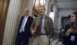 Sen. Angus King, I-Maine, (left) and Sen. John Kennedy, R-La., arrive for votes on Capitol Hill in Washington, Monday evening, Nov. 27, 2017. (AP Photo/J. Scott Applewhite)