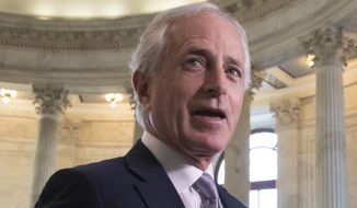 Sen. Bob Corker, Tennessee Republican, is helping lead the push to include a trigger in the package and has consistently said he doesn't want to vote for something that will explode federal deficits. (Associated Press/File)