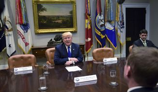 President Donald Trump, center speaks in the Roosevelt Room of the White House in Washington, Tuesday, Nov. 28, 2017, during a meeting with Republican congressional leaders. House Speaker Paul Ryan of Wis., sits at right and White House budget director Mick Mulvaney is at front right. Trump is flanked by two empty seats for Senate Minority Leader Sen. Chuck Schumer of N.Y., left, and House Minority Leader Nancy Pelosi of Calif., right. (AP Photo/Susan Walsh)