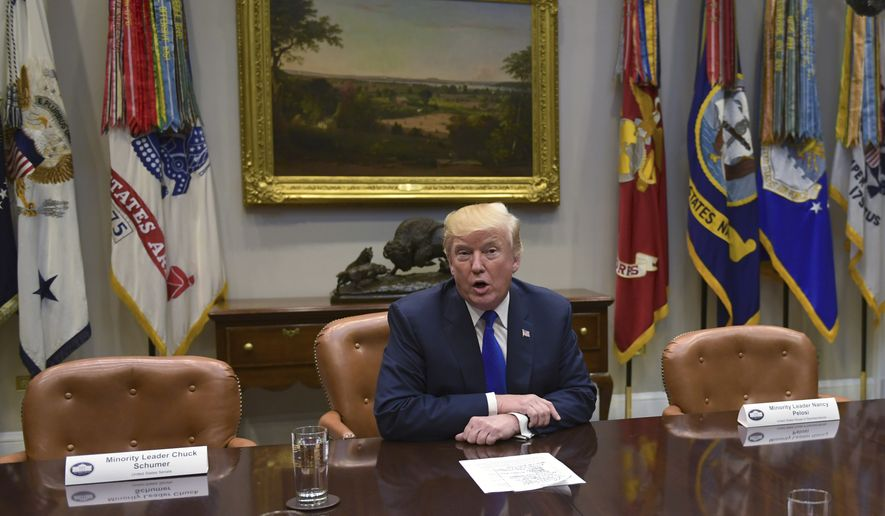 President Trump, flanked by empty seats for Senate Minority Leader Charles E. Schumer of New York and House Minority Leader Nancy Pelosi of California met with congressional leaders at the White House on Tuesday. (Associated Press)