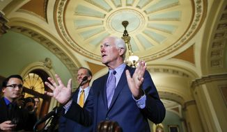 Sen. John Cornyn, R-Texas, talks with the media after Senate Republicans met with President Donald Trump on Capitol Hill, Tuesday, Nov. 28, 2017, in Washington. (AP Photo/Alex Brandon) ** FILE **