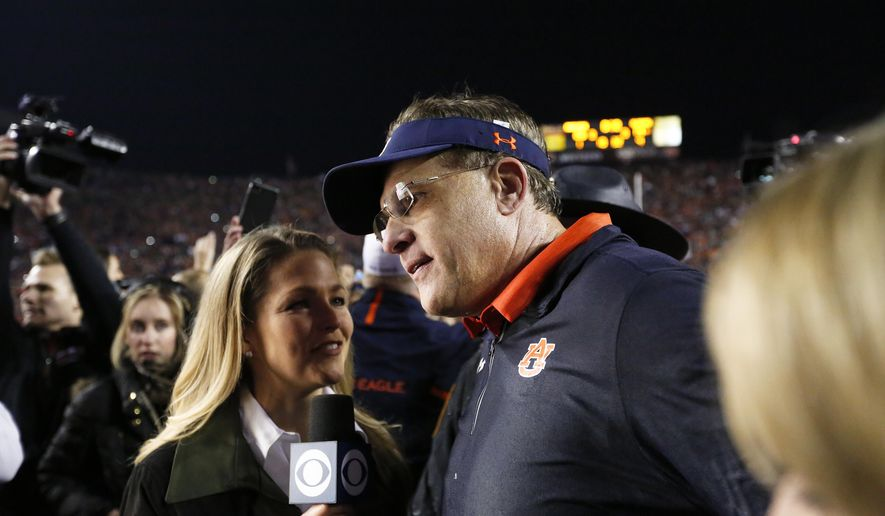 Auburn head coach Gus Malzahn walks off the field after the Iron Bowl NCAA college football game, Saturday, Nov. 25, 2017, in Auburn, Ala. Auburn won 26-14. (AP Photo/Brynn Anderson)