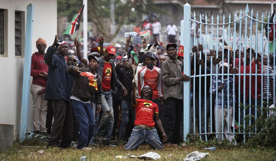 Supporters of President Uhuru Kenyatta engage in rock-throwing clashes with police at his inauguration ceremony after trying to storm through gates to get in and being tear-gassed, at Kasarani stadium in Nairobi, Kenya Tuesday, Nov. 28, 2017. Kenyan President Uhuru Kenyatta is being sworn in on Tuesday, ending a months-long election drama that saw the first vote nullified by the country's top court and the second boycotted by the opposition. (AP Photo/Ben Curtis)