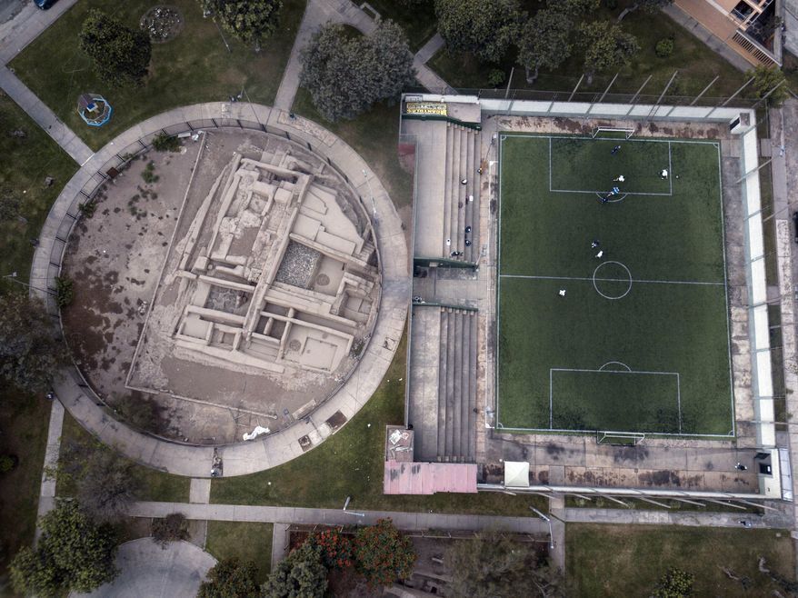 In this Sept. 22, 2017 photo, the pre-Columbian archeological site La Luz is flanked by a private soccer field players rent in Lima, Peru. Many people in modern-day Peru are raised among the Incan ruins built before the Spanish colonized South America. (AP Photo/Rodrigo Abd)