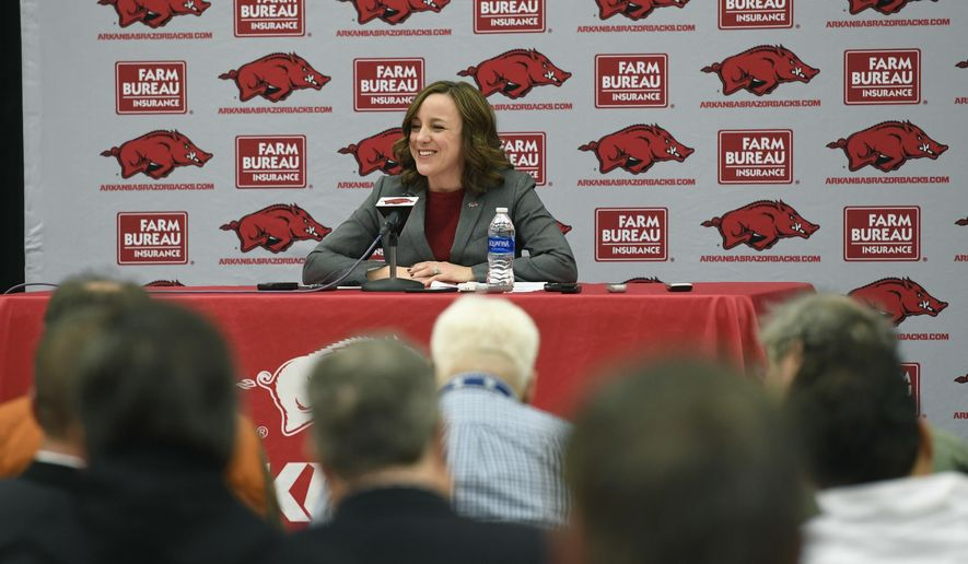 FILE - In this Nov. 24, 2017, file photo, Julie Cromer Peoples, interim athletic director for the University of Arkansas, talks about the decision to fire Arkansas coach Bret Bielema  at a press conference in Fayetteville, Ark. Arkansas will use a pair of firms to aid in the search for its new athletic director and football coach. The school announced the hiring of firms Korn Ferry and DHK International on Tuesday, Nov. 28, 2017, two weeks after Chancellor Joseph Steinmetz fired former athletic director Jeff Long _ and less than a week after interim athletic director Julie Cromer Peoples fired former coach Bret Bielema.  (AP Photo/Michael Woods, File)