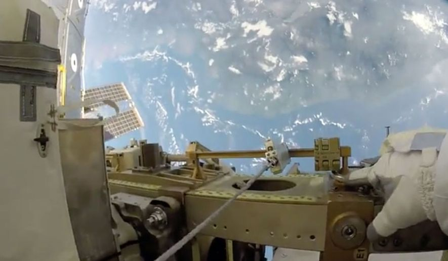 "Astronaut Randy ""Komrade"" Bresnik captures a  view of Earth as he carries out maintenance work on the International Space Station. (Storyful)"