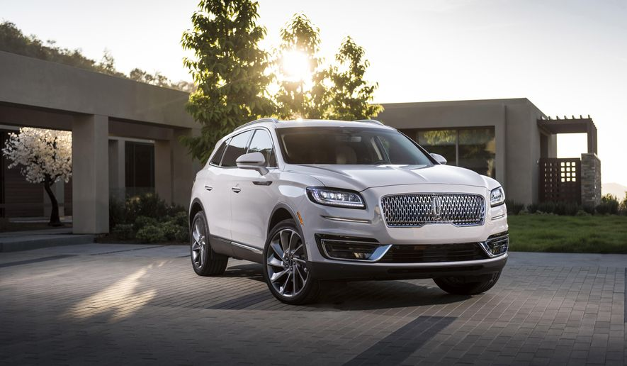 This photo provided by Ford Motor Co. shows the 2019 Lincoln Nautilus. The 2019 Nautilus swaps its V6 engine for two turbocharged four-cylinder choices. (James Lipman/Ford Motor Co. via AP)