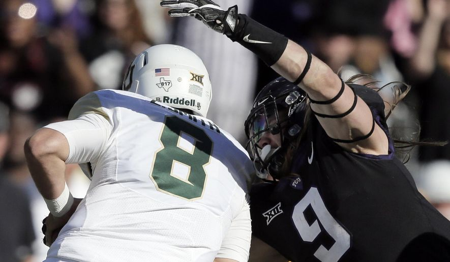 FILE - In this Nov. 24, 2017, file photo, TCU defensive end Mat Boesen (9) sacks Baylor quarterback Zach Smith (8) during the second half of an NCAA college football game, in Fort Worth, Texas. The No. 10 Horned Frogs hope to have Boesen back for an entire game in the rematch against the No. 2 Sooners, this time in the Big 12 championship game Saturday that comes a week after his TCU single-game record 5 1/2 sacks against Baylor. (AP Photo/Brandon Wade, File)