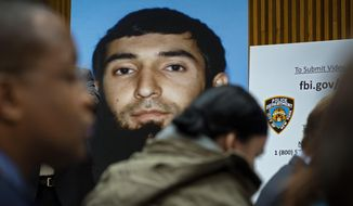 FILE - This Nov. 1, 2017, file photo shows a photo of Sayfullo Saipov displayed at a news conference at One Police Plaza in New York. In Manhattan federal court on Tuesday, Nov. 28, Saipov, who has been charged in a deadly truck rampage in New York City, pleaded not guilty to an indictment including multiple potential death-penalty counts. (AP Photo/Craig Ruttle, File)