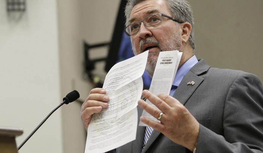 Assemblyman Ken Cooley, D-Rancho Cordova, displays state and legislative policies concerning sexual harassment during a committee hearing tasked with revising the California Assembly's sexual harassment policies, Tuesday, Nov. 28, 2017, in Sacramento, Calif. Cooley, chair of the Assembly rules committee detailed how harassment complaints against members of the Assembly are handled. (AP Photo/Rich Pedroncelli)