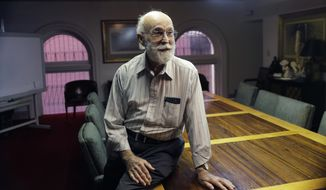 In this Tuesday, Nov. 28, 2017 photo, Joe Holcombe visits with an attorney as he waits for an interview, in San Antonio. Holcombe, who lost eight members of his family in a shooting that killed more than two dozen people at a Texas church including his son Bryan, filed a claim on Tuesday against the U.S. Air Force, alleging the agency's failure to report the criminal history of the gunman to an FBI database used to check the backgrounds of gun buyers helped cause his loved one's death. (AP Photo/Eric Gay)