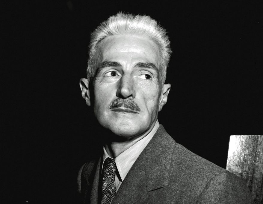 """FILE - In this Nov. 7, 1947 file photo, novelist Dashiell Hammett, author of """"The Maltese Falcon"""" and """"The Thin Man,"""" appears in New York. A Hammett story about a tormented killer is being published for the first time in more than 90 years. """"The Glass That Laughed"""" first ran in the November 1925 issue of True Police Stories, a magazine which lasted just two years. It will run online Wednesday in Electric Literature (https://electricliterature.com). (AP Photo, File)"""