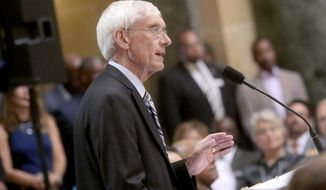 FILE - In this Sept. 21, 2017 file photo, Wisconsin state schools superintendent Tony Evers speaks in the rotunda of the Wisconsin State Capitol in Madison, Wis. Evers detailed his reasoning for refusing to be represented by the Republican-led state Department of Justice in a lawsuit filed by a conservative law firm targeting his rule-making powers on Tuesday, Nov. 28, 2017, in Madison. (John Hart /Wisconsin State Journal via AP, File)