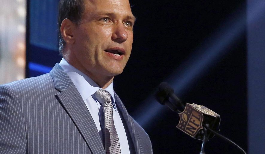 FILE – In this May 1, 2015, file photo, former NFL player and Ohio State linebacker Chris Spielman speaks at the 2015 NFL Football Draft in Chicago. Spielman has expanded his federal antitrust lawsuit alleging improper use of ex-players' images in marketing campaigns to include thousands of former athletes, according to an updated complaint filed Tuesday, Nov. 28, 2017. The updated lawsuit names IMG and Nike as defendants, and Honda, Ohio State and other universities as co-conspirators. (AP Photo/Charles Rex Arbogast, File)