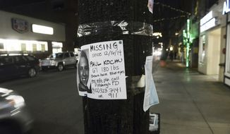 In this Dec. 20, 2014 photo, a sign posted on Walnut Street, in Pittsburgh, asks for information on Paul Kochu, a missing 22-year-old South Side man. Kochu's body was found March 19, 2015, floating 85 miles downriver in Wheeling, West Virginia.  As the anniversary of his approaches, both his family and Pittsburgh police still do not know what happened.  (Bill Wade/Pittsburgh Post-Gazette via AP)