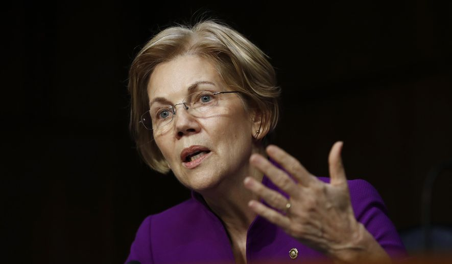 Senate Banking, Housing, and Urban Affairs Committee member Sen. Elizabeth Warren, D-Mass., questions Jerome Powell, President Donald Trump's nominee for chairman of the Federal Reserve, during a Senate Banking, Housing, and Urban Affairs Committee hearing on Capitol Hill in Washington, Tuesday, Nov. 28, 2017. (AP Photo/Carolyn Kaster) ** FILE **