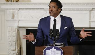 """FILE - In this Sept. 8, 2016 file photo, Kennedy Center's Artistic Director for Hip-Hop Culture, Q-Tip, reads a poetry, during the National Student Poets event, in the State Dining Room of the White House in Washington. Q-Tip of A Tribe Called Quest is blasting the Grammys in an angry video for failing to recognize the band's final album with a nomination. The rapper-producer tells off the organization and calls it """"corny"""" in an expletive-filled rant posted Tuesday, Nov. 28, 2017, on Instagram. (AP Photo/Manuel Balce Ceneta, File)"""
