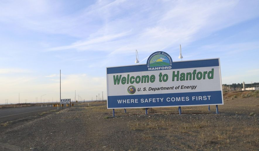 FILE - In this May 9, 2017 file photo, a sign welcomes drivers to Hanford Nuclear Reservation in Richland, Wash. After almost two decades of work, the government has nearly finished removing radioactive wastes from a first group of underground storage tanks in eastern Washington. (AP Photo/Manuel Valdes, file)