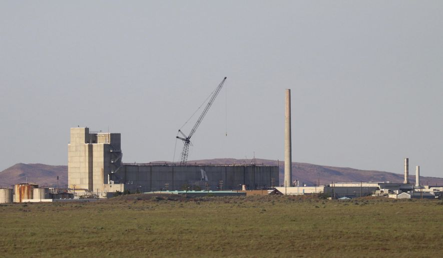 The Energy Department could save tens of billions of dollars if it labeled radioactive waste at a disposal site in Washington state as a lower risk to public health, and subsequently treated and disposed of it more quickly. (Associated Press/File)