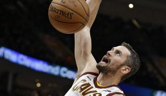 Cleveland Cavaliers' Kevin Love dunks the ball against the Miami Heat in the first half of an NBA basketball game, Tuesday, Nov. 28, 2017, in Cleveland. (AP Photo/Tony Dejak)