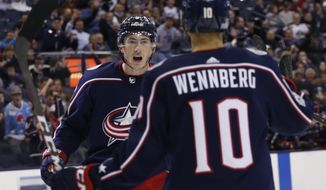 Columbus Blue Jackets' Zach Werenski, left, celebrates his goal against the Carolina Hurricanes during the second period of an NHL hockey game Tuesday, Nov. 28, 2017, in Columbus, Ohio. (AP Photo/Jay LaPrete)
