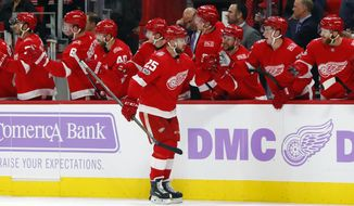 Detroit Red Wings defenseman Mike Green (25) celebrates his goal against the Los Angeles Kings in the first period of an NHL hockey game Tuesday, Nov. 28, 2017, in Detroit. (AP Photo/Paul Sancya)