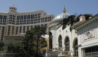 FILE - This April 14, 2017 file photo shows the Bellagio casino and resort in Las Vegas. Police in Las Vegas say they are looking for an armed suspect who fled from the Bellagio casino-resort after he demanded money from a cashier area. Police say the man wore a mask when he approached the poker cage on Tuesday, Nov. 28, 2017. (AP Photo/John Locher, File)