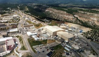 FILE - This undated file aerial photo shows the Los Alamos National laboratory in Los Alamos, N.M. As New Mexico lawmakers debate possible changes to the state's tax structure, one concern is whether purchases made by national laboratories located in the state will continue to result in gross receipts tax revenue. Data presented to lawmakers shows the for-profit consortium that currently manages Los Alamos National Laboratory has paid between $48 million and $100 million a year in gross receipts taxes. (The Albuquerque Journal via AP)