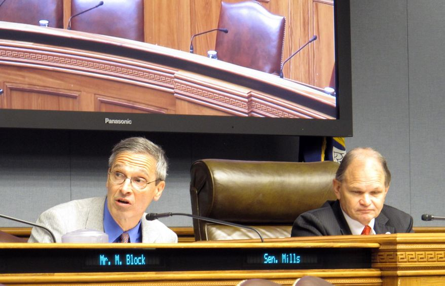 State Sen. Fred Mills, R-Parks, left, asks questions about Medicaid prescription drug spending during the meeting of a task force looking at ways to cut state Medicaid costs, Tuesday, Nov. 28, 2017, in Baton Rouge, La. (AP Photo/Melinda Deslatte)