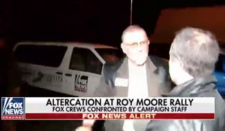 Campaign staffers for embattled Republican Senate candidate Roy Moore reportedly manhandled two Fox News photographers outside a rally in northern Alabama Monday night. (Fox News)