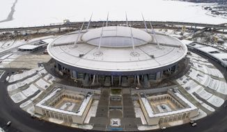 FILE- In this Thursday, Dec. 29, 2016 file photo, a view of the soccer stadium, which were under construction on Krestovsky Island, in St.Petersburg, Russia. The Russian soccer federation has asked UEFA to pick St. Petersburg as host for the opening match of the 2020 European Championship. The host will be chosen on Dec. 7, 2017. (AP Photo/Dmitri Lovetsky, File)