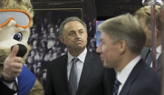 Vitaly Mutko, Russian Federation Deputy Prime Minister & Local Organising Committee Chairman reacts walking inside a metro train branded for the 2018 World Cup during a ceremony in Moscow, Russia, on Tuesday, Nov. 28, 2017. (AP Photo/Ivan Sekretarev)