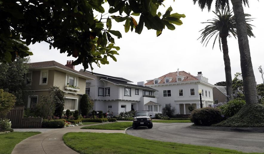 FILE - In this Aug. 7, 2017 file photo, is an overview of the Presidio Terrace neighborhood in San Francisco. Wealthy homeowners whose private, gated and very exclusive San Francisco street was auctioned off after decades of unpaid taxes are asking supervisors to undo the sale Monday, Nov. 27, 2017, prompting cries of elitism in a city obsessed with property and fairness. (AP Photo/Marcio Jose Sanchez, File)