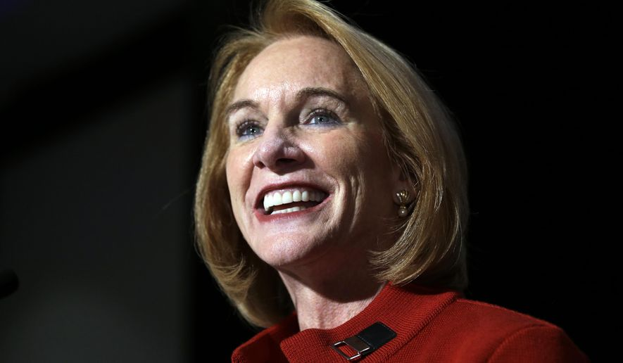 In this Nov. 7, 2017 photo, Seattle mayoral candidate Jenny Durkan smiles as she begins to address supporters on election night in Seattle. Former U.S. Attorney Jenny Durkan will be sworn in Tuesday, Nov. 28, 2017, as Seattle's mayor, becoming only the second woman to lead the Northwest's largest city. (AP Photo/Elaine Thompson)