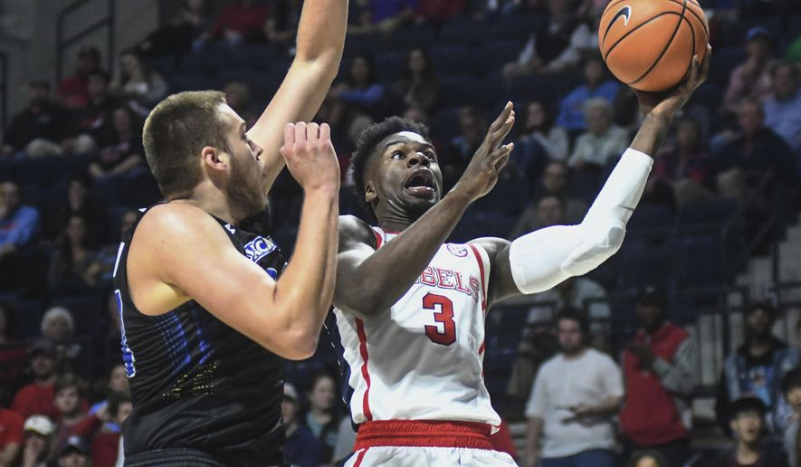Mississippi's Terence Davis (3) shoots against South Dakota State's Mike Daum (24) in an NCAA college basketball game in Oxford, Miss., Tuesday, Nov. 28, 2017. (Bruce Newman/The Oxford Eagle via AP)