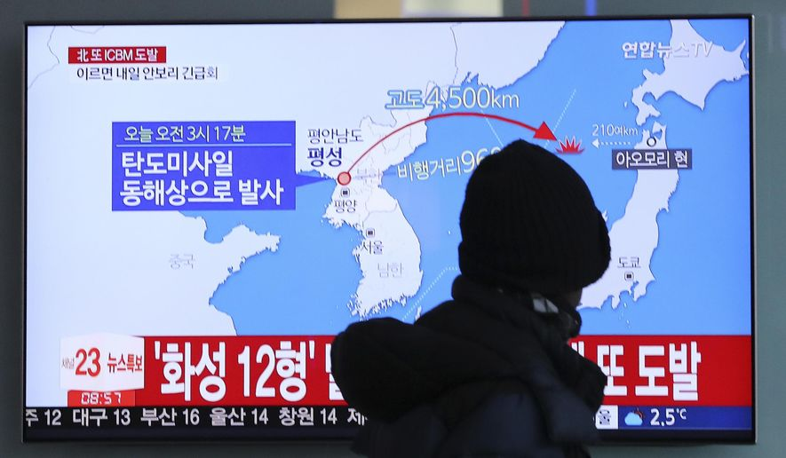 """North Korea abruptly ended a 10-week pause in its weapons testing by launching what the Pentagon said was an intercontinental ballistic missile, apparently its longest-range test yet, a move that will escalate already high tensions with Washington. The Korean letters read """"Fired ballistic missile."""" (Associated Press)"""
