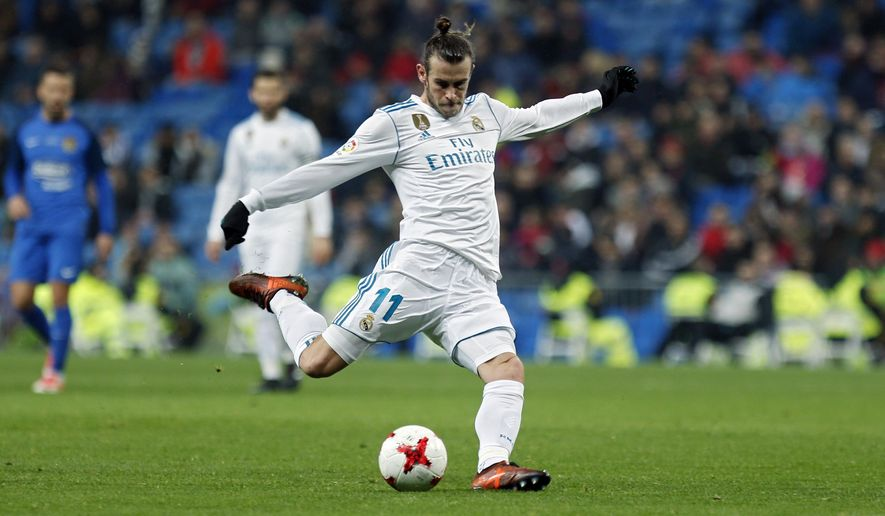 Real Madrid's Gareth Bale shoots the ball during a Spanish Copa del Rey round of 32 second leg soccer match between Real Madrid and Fuenlabrada at the Santiago Bernabeu stadium in Madrid, Tuesday, Nov. 28, 2017. Real Madrid won 4-2 on aggregate. (AP Photo/Francisco Seco)