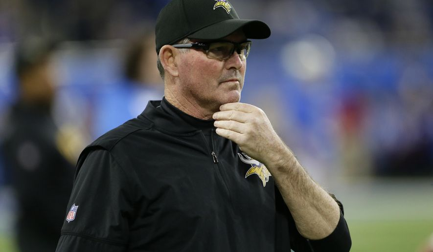 FILE - In this Nov. 23, 2017, file photo, Minnesota Vikings head coach Mike Zimmer watches from the sidelines before an NFL football game against the Detroit Lions, in Detroit. The Vikings are in control of a prime spot in the playoffs with five games to go, but there's no time to look at seeding scenarios or competitor schedules. The NFC race is stacked, leaving little room for lapses.(AP Photo/Duane Burleson, File)