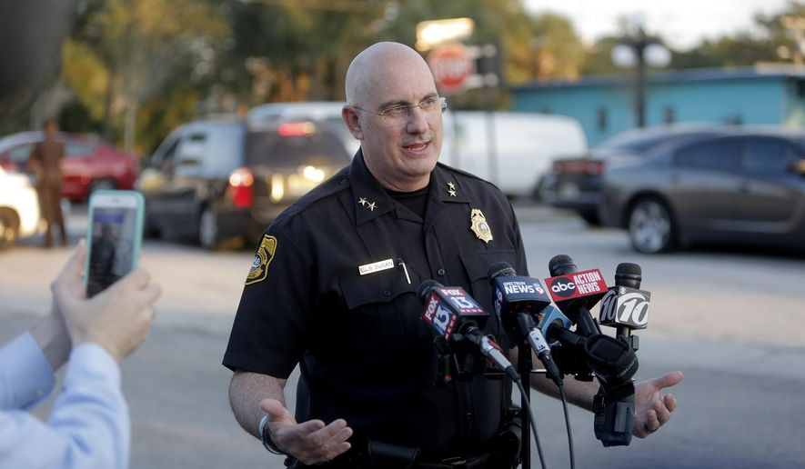 Tampa Police Chief Brian Dugan holds a news conference in a parking lot behind the Ybor City McDonalds on Tuesday, Nov. 28, 2017, in Tampa, Fla. (Octavio Jones/Tampa Bay Times via AP)
