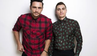 """In this Nov. 15, 2017 photo, James Franco, left, and Dave Franco pose for a portrait in New York to promote their film, """"The Disaster Artist."""" (Photo by Taylor Jewell/Invision/AP)"""