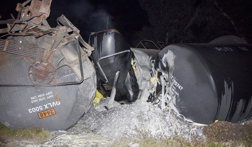 This photo made available by Polk County Fire Rescue shows molten sulfur that spilled from a derailed train near Lakeland, Fla., Monday, Nov. 27, 2017. State officials are investigating the crash. (Polk County Fire Rescue via AP)