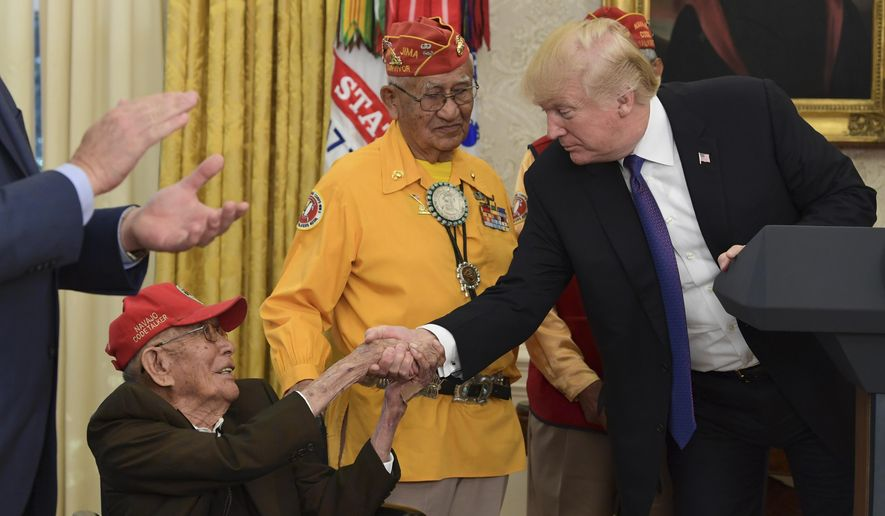 In this file photo, President Donald Trump meets with Navajo Code Talkers, Fleming Begaye Sr., seated and Thomas Begay, center, in the Oval Office of the White House in Washington, Monday, Nov. 27, 2017. On June 3, 2019, The Navajo Nation announced that another World War II-era Navajo Code Talker, William Tully Brown, has died at age 96. He's the third Navajo Code Talker to die since May 10. (AP Photo/Susan Walsh) **FILE**