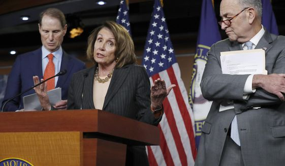 In this Nov. 2, 2017, file photo, House Minority Leader Nancy Pelosi, D-Calif., flanked by Sen. Ron Wyden, D-Ore., the ranking member of the Senate Finance Committee, left, and Senate Minority Leader Chuck Schumer, D-N.Y., holds a news conference on Capitol Hill to respond to the Republican tax reform plan in Washington. (AP Photo/J. Scott Applewhite)